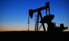 Тегеран согласился приостановить добычу нефти