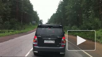 Из-за лесовоза стоит Приозерское шоссе