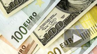 Рубль немного подрос по отношению к доллару и евро